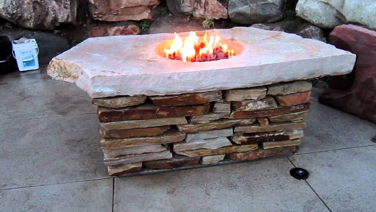 Natural rock fire pit table mov youtube for Making a fire pit with rocks
