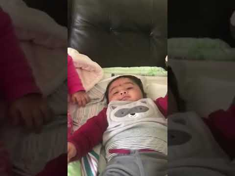 Precious moment between sister and baby brother