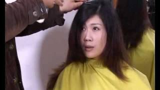 Lady model in long dye hair cut to short