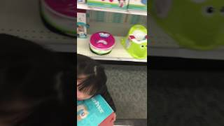 It's all about this Fisher-price learn-to-flush-potty training chair...