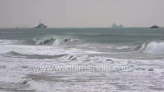 Gushing sea waves of the Bay of Bengal on the Odisha coastline, with cargo ships and trawlers