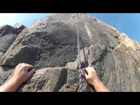 Rock climbing Otter Cliffs in Acadia National Park, Maine