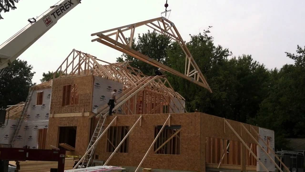 Setting trusses with crane youtube for Roof trusses installation