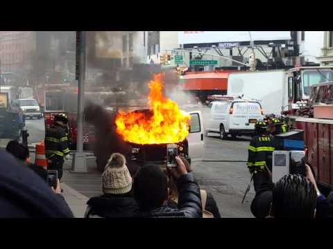 Car is on fire in Canal St Chinatown NYC