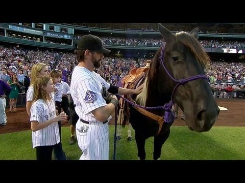 Helton catches first pitch, receives horse