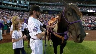 Todd Helton catches daughter's first pitch, receives horse in last home game