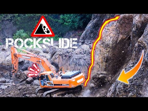 CRAZY Close Call BiG Digger Excavator Cause A Huge Rock Slide