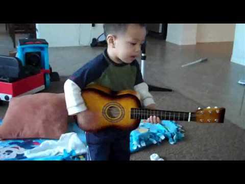 Baby Boy Playing Guitar