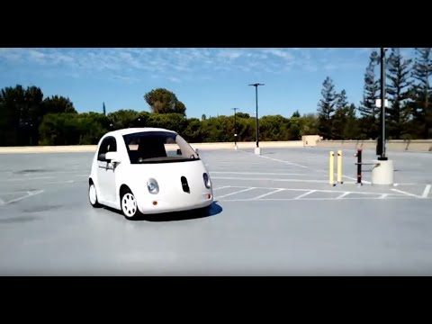 Google X self driving car with pedestrian and bike