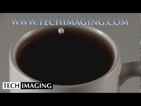 High Speed Camera Video - Milk dropping into coffee