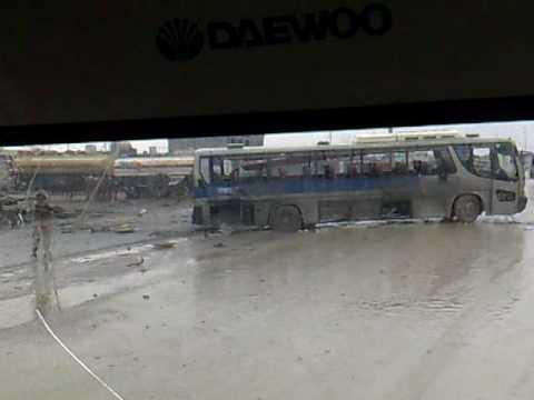 one of the exploded buses احد الباصات المتضررة