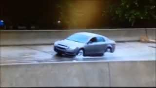 SPLASH! Driver learns to roll up window when travelling through puddles