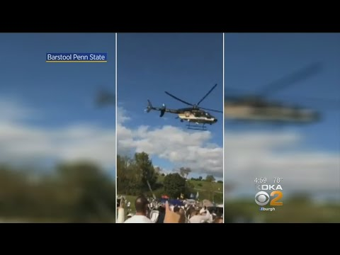 Low-Flying Police Helicopter Sends Tents, Corn Hole Games Fl