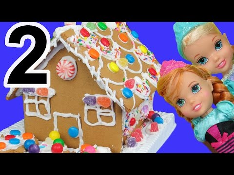 Gingerbread house DECORATING! ELSA, ANNA toddlers use candies, sprinkles, royal icing!