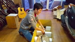 Guitar isaac. Đóng gói đàn Guitar để vận chuyển.
