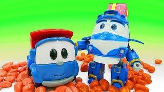 Фото Машинки Грузовичок Лева и Роботы-поезда. Истории игрушек. Развивающее видео собираем пазлы