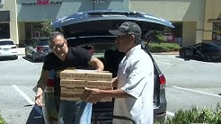 Orlando kickboxing club owner delivering pizzas to local hospitals