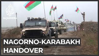 Azerbaijan enters Nagorno-Karabakh district after peace deal