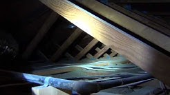 Attic of a 1970s Home before Re-Insulation