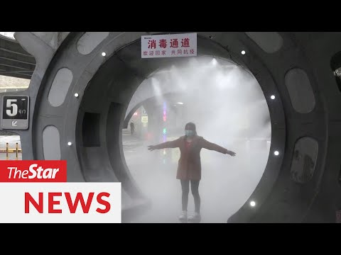 covid-19:-disinfectant-tunnel-in-china-sprays-workers