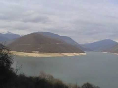 """Jinvali's reservoir, """"mysterious"""" island and snow mountains"""