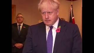 英首相约翰逊悼念集装箱尸体惨案中遇难者
