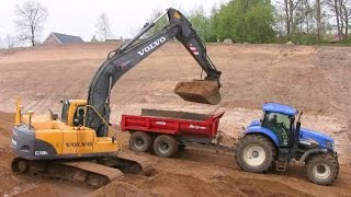 Volvo Ec210b Excavator Loading John Deere And New Holland Tractors