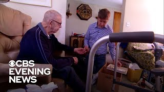 Steve Hartman helps his father move out of their family home
