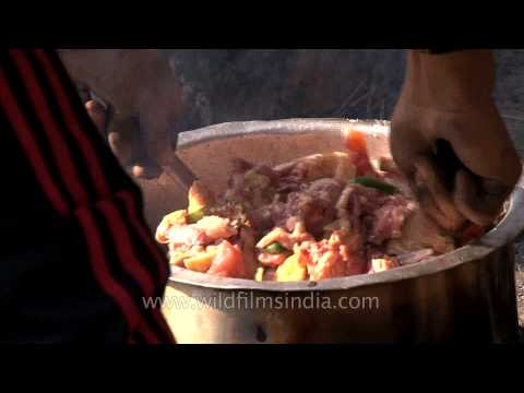 Trekkers enjoy a Naga style Chicken meal in Dzukou Valley, Nagaland