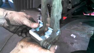 Front brake pad replacement Subaru Outback 2002 - 2012 rotor Install Remove Replace How to(, 2014-10-01T15:03:51.000Z)