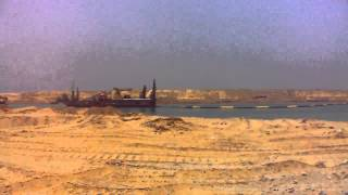 Gorgeous scenery of the dredgers in the new Suez Canal in a long queue