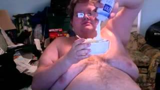 Fatman eats a whole can of whipped cream while the world around him burns