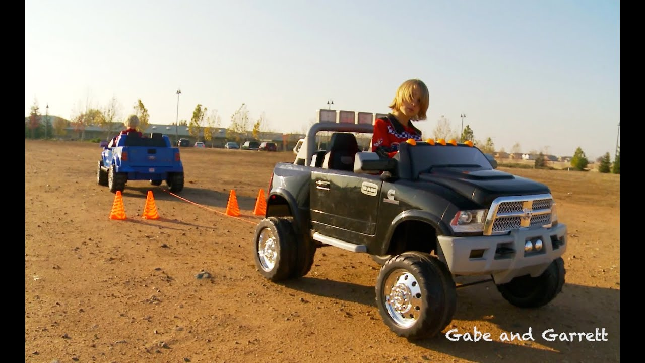 power wheels tug of war 1 ford f 150 vs dodge ram youtube. Black Bedroom Furniture Sets. Home Design Ideas
