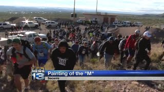 New Mexico Tech students climb Socorro Peak to 'Paint The M'