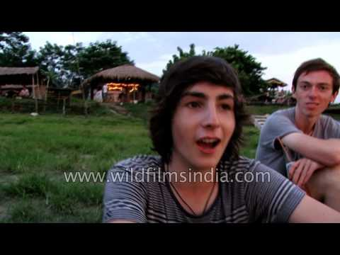 Tourists speak about sunset in Chitwan, Nepal