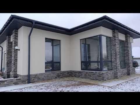 Красивый одноэтажный дом утеплён фасадным пенопластом система Ceresit, фрагменты камень White Hills