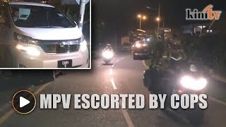 White Vellfire escorted by cops seen leaving Najib's house