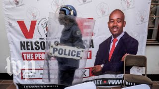 Zimbabwe police in riot gear briefly break up opposition news conference