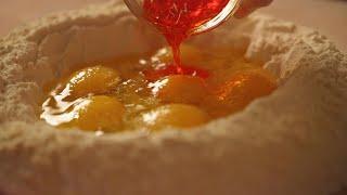 Vicini Pastaria | Wild Ramp Saffron Culurgiones & Almond-Arugula Pesto