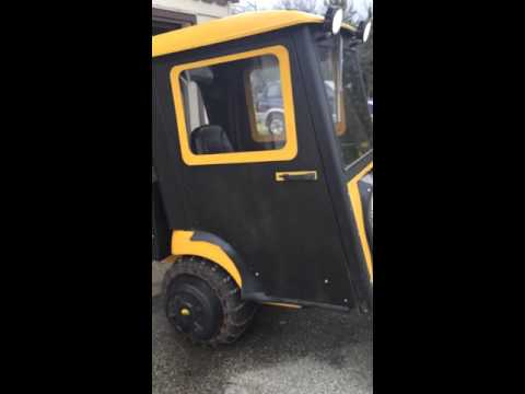 Cub cadet with enclosure cab and snowblower by Logan Wells
