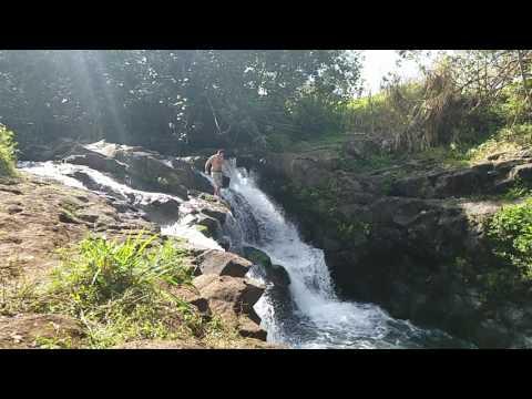 Waterfall swan dive at Ho'opi'i Falls, Kauai