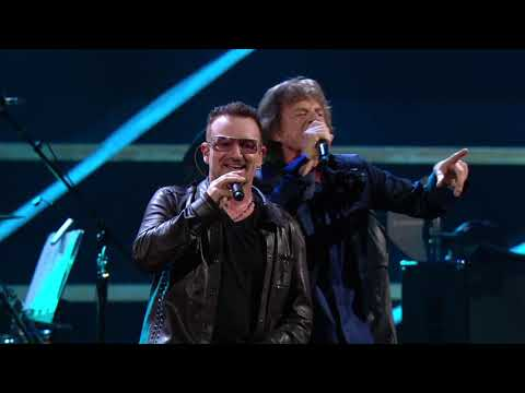 "U2 and Mick Jagger perform ""Stuck in a Moment You Can't Get Out Of"" at the 25th Anniversary concert."