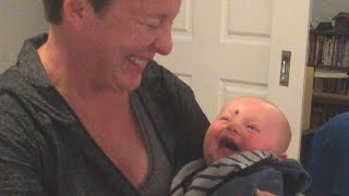 Baby Laughs at Mom Putting Pacifier in Mouth