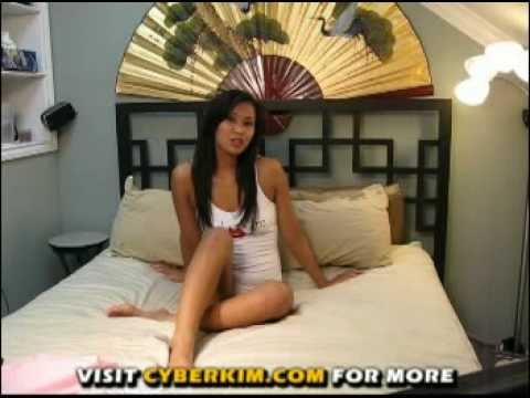 Pretty Asian chick in front of her webcam
