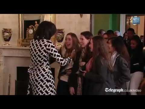 Michelle Obama and dog Bo surprise White House visitors