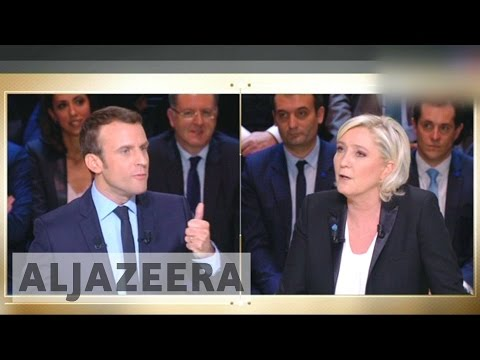 French presidential hopefuls clash on immigration in live debate