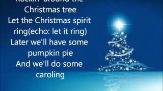 Miley Cyrus - Rockin Around The Christmas Tree (Lyrics)