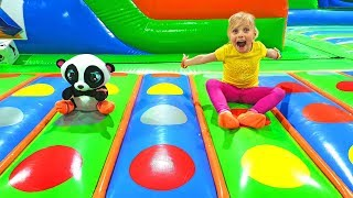 Alice and Panda play on inflatable slide at Indoor Playground