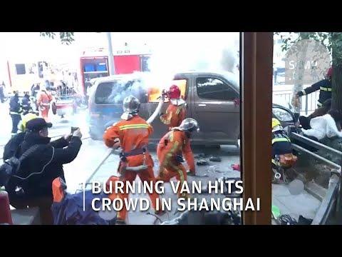 Burning van crashes into crowd outside Shanghai Starbucks, injuring 18