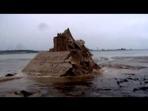 JERSEY CHANNEL ISLANDS ..MASSIVE TIDAL ACTION THROWS UP SAND BANK WHICH RESEMBLES A MEDIEVAL CASTLE